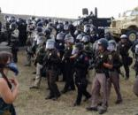 Water-protectors are forced back by DAPL law enforcement in North Dakota. / Photo by garnpress.com via Blasting News library