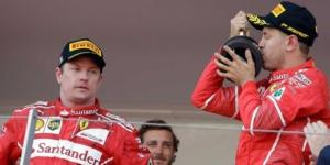 Kimi Raikkonen can't hide his disappointment as Sebastian Vettel beats him to Monaco glory. (Source: sportsnet.ca)