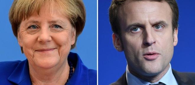 Macron beato tra le donne (mature) a Berlino