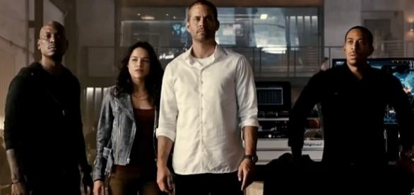 """Photo Paul Walker and the cast of """"Furious 7"""" screen capture from YouTube video/Wiz Khalifa"""