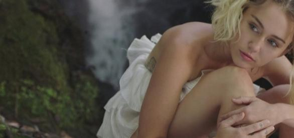 """Miley Cyrus in a screen shot from her """"Malibu"""" music video - Flickr/Kurres Edlund"""