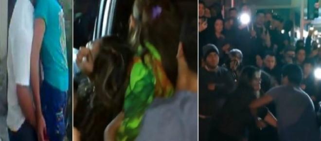 Traída flagra marido com a prima dela e espanca os dois com ajuda da multidão