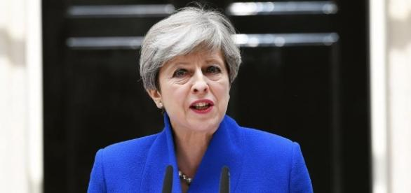 Theresa May apologises over election disaster but vows to lead ... - thesun.co.uk